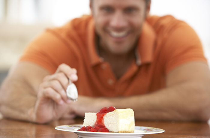 Middle Aged Man Eating Cheesecake